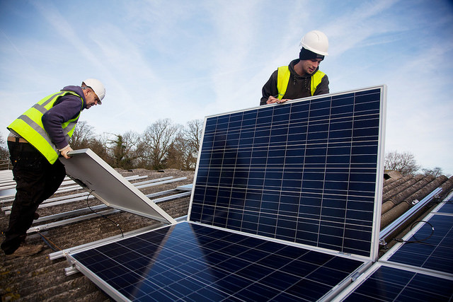 solar installers on roof