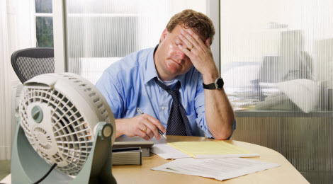 sweating office worker